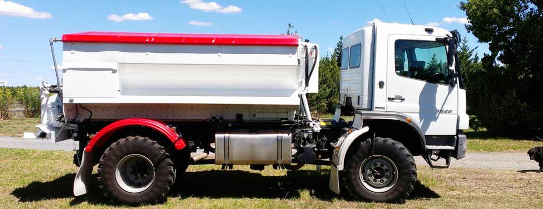 AFS trucks with matching red tarps and wheel guards